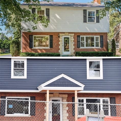 can you brick a house with siding picking blue exterior siding with red brick home with keki