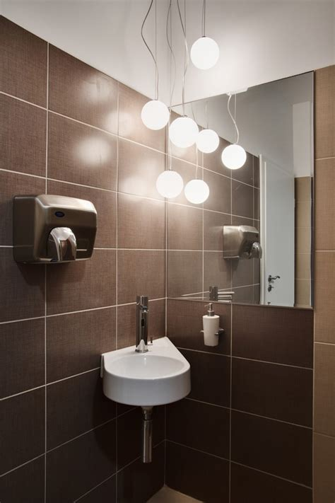 bathroom division friendly dental office with baroque design influences in
