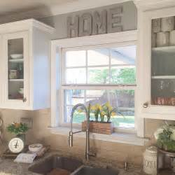 kitchen window decor ideas i like the raised window and the glass cabinets around it