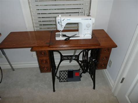 singer sewing machines that fit in cabinets this singer sewing cabinet was repurposed to fit my