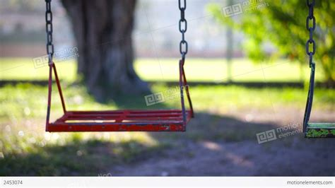 swing lifestyle video empty swing in a children s playground stock video footage