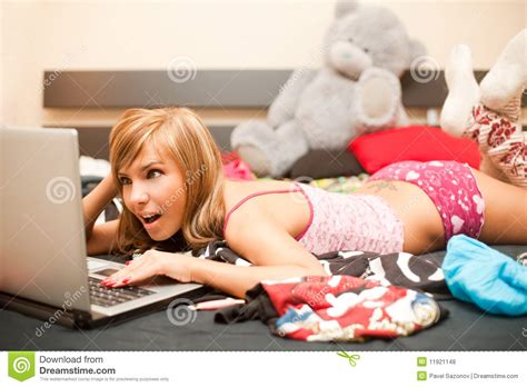 teens in bed teen girl in bed with laptop royalty free stock photos