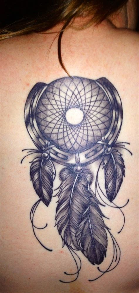 horseshoe and dreamcatcher tattoo on back tattooimages biz