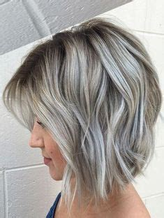 gray hair in mid thirties lowlights and highlights to soften the transition to grey