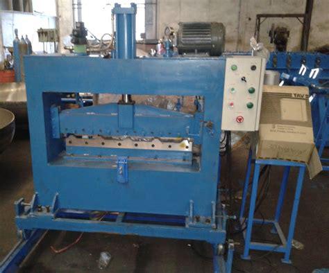 Mesin Jahit Di Seng Heng memproduksi mesin rol forming atap mesin sliter mesin