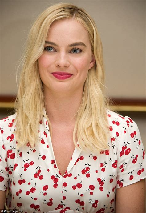 robbie e figure margot robbie cuts a demure figure in and fruity
