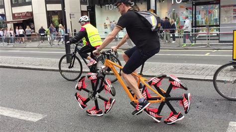 bike riding sneakers guy rides bike with shoes as wheels youtube