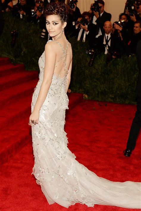 Catwalk To Carpet Emmy Rossum by Emmy Rossum Showing Big Cleavage In White Lace Partially