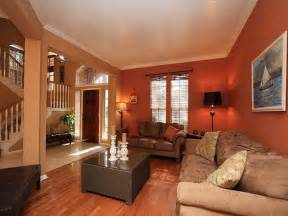 deep orange wall color with velvet beige sofa set for small living room ideas using traditional