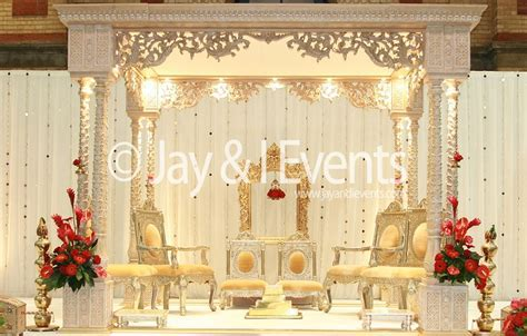 Mandap with internal lighting and simple backdrop (Jay and