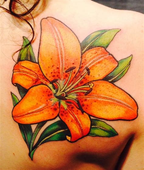 blue tiger lily tattoo my first color tattoo a