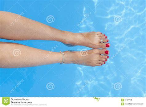 female swimmer hygiene female feet by the poolside stock photo cartoondealer