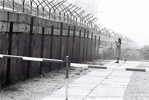 iron curtain wall ria novosti putin s spokesman rules out return of iron