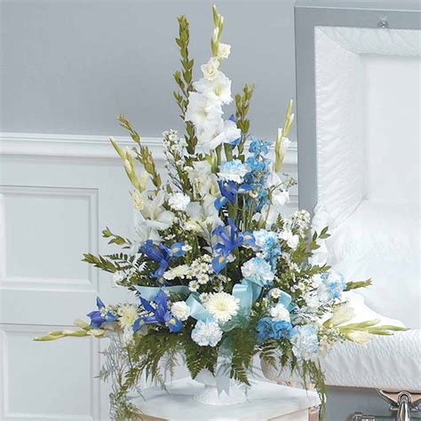light blue flower arrangements blue white funeral arrangement