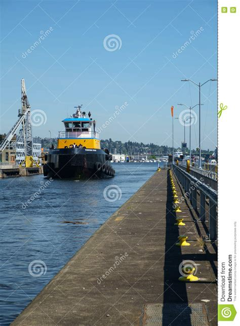 yellow tugboat large blue and yellow tugboat at ballard locks seattle