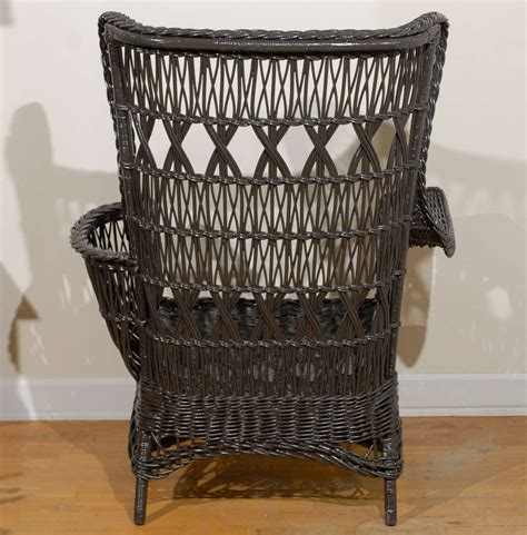 Antique Wicker Chair by Antique American Wicker Wing Chair With Magazine Pocket At