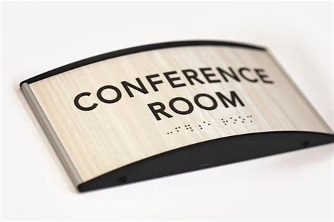 conference room ada braille signs curved wood conference