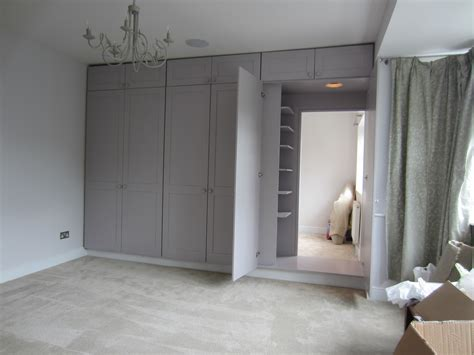 wardrobe doors reveal dressing room containing