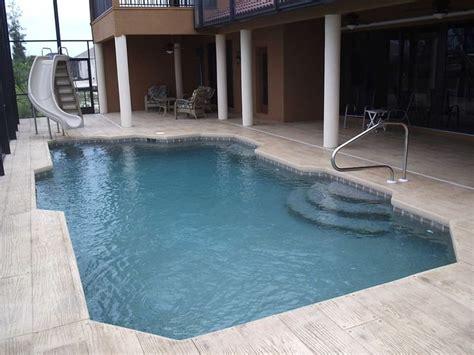 stamped concrete deck wood  elite weiler pools