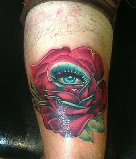 eye rose tattoo 2 unique orange on thigh