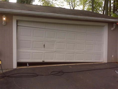 Open Garage Door With Broken by Broken Garage Door 2 A Plus Garage Doors
