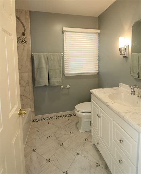 baldwin cool toned bath with mosaic tiled baseboards