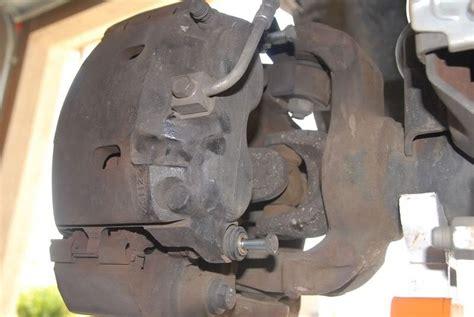 service manual how to repair front brake caliper 2005