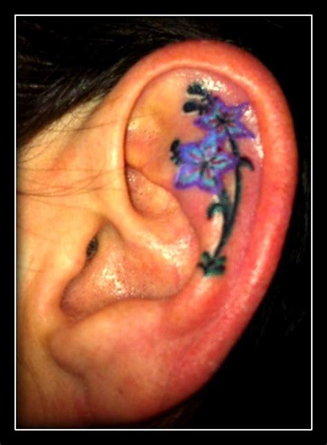 flower tattoo in ear with piercing 25 best ideas about inner ear tattoo on pinterest ear