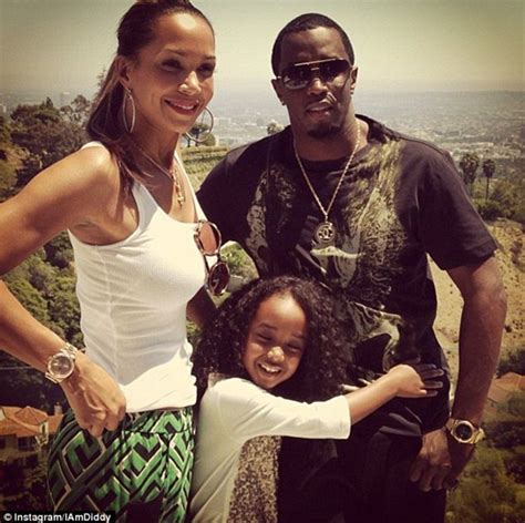Diddy And Show The Babies by Diddy Poses With His Six Children For Family