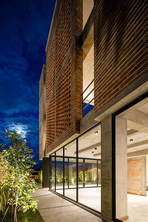 green facade distinct double story porch greets
