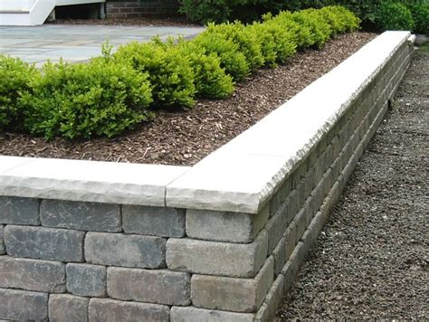 Unilock Olde Quarry unilock olde quarry retaining wall with bedford limestone cap with rock faced edges