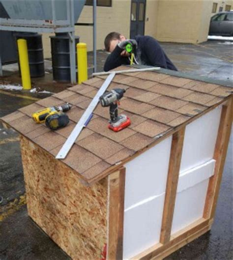 build a warm dog house students build houses for dogs in need westside news
