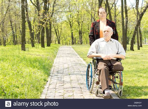 one leg wheelchair walking a disabled in a wheelchair who has had