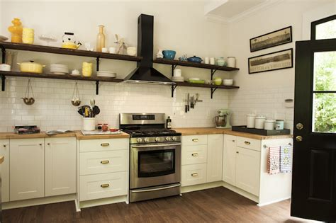 stacked wood kitchen shelves with iron brackets ikea kitchen cabinets country kitchen hgtv