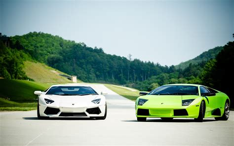 Car Wallpaper Road by Two Lamborghini Cars On Road Hd Wallpapers Rocks