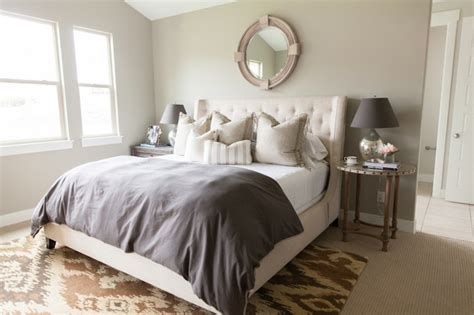 mirror above headboard cream tufted headboard transitional bedroom alice