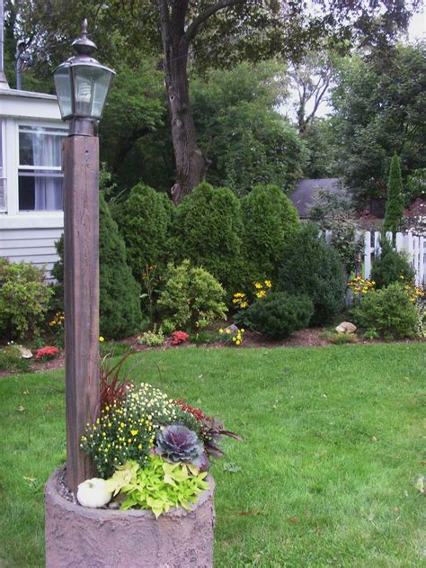 front yard light post front yard l post fall planting white pumpkin mums