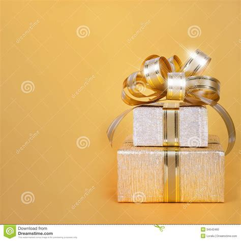 Beautiful Gift Box In Gold Wrapping Paper Stock Photo