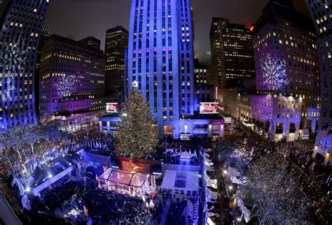 thousands gather for nyc rockefeller center christmas tree