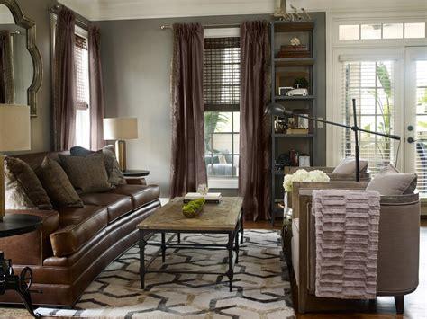 brown leather sofa  grey carpet