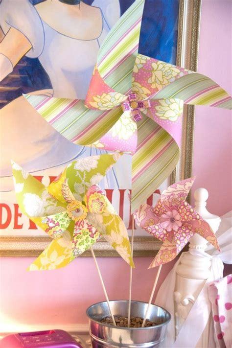 para bautizo compuesta por cuatro centros de flores de papel para originales ideas para los centros de mesa infantiles