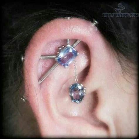 four piercing industrial ear bar mods