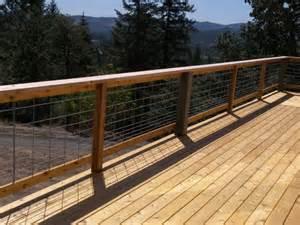 cedar deck with hog panel rail tnt builders