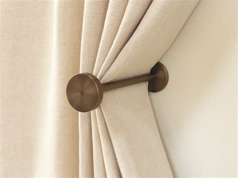 where to put curtain holdbacks brushed bronze curtain holdbacks simple elegant design