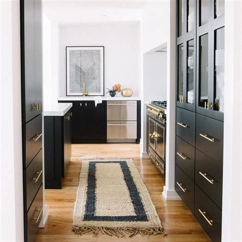 white kitchen cabinets with black hardware black kitchen cabinets with brass hardware contemporary