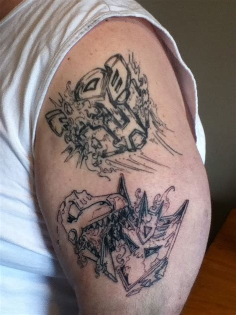 stages of a tattoo transformers autobot and decepticon logo featuring