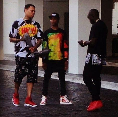 is wizkid the inspiration behind chris browns new haircut davido wears same shoe with wizkid clothe with chris