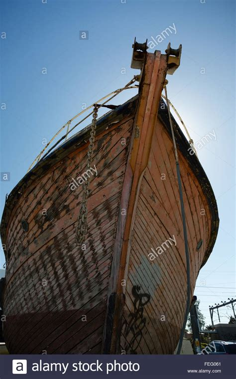 wooden boat bow view of bow of an old wooden boat in dry dock stock photo