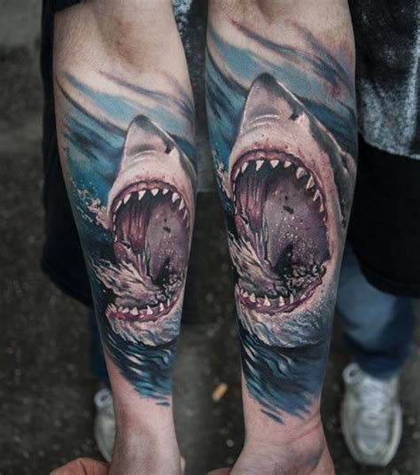 arm realistic shark tattoo by pawel skarbowski