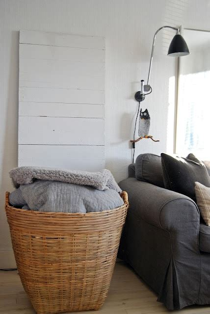 blanket storage ideas that look great for every room in a large basket in the living room to store all cozy